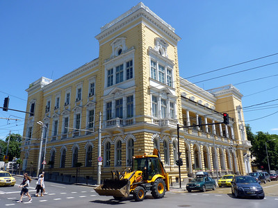 Yellow building, yellow tractor