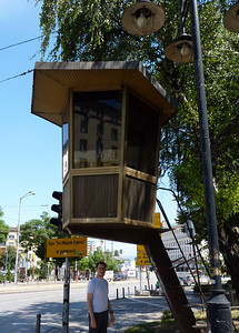 Funny lifeguard huts that were at a bunch of the intersections in the city